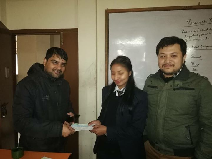 1591900249 261 Scholarship distribution to Sujita poudel college topper of BSW II