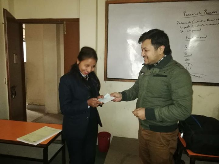 Scholarship distribution to Sujita poudel college topper of BSW II